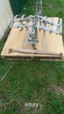 Vintage one horse drawn cultivator for garden with single tree